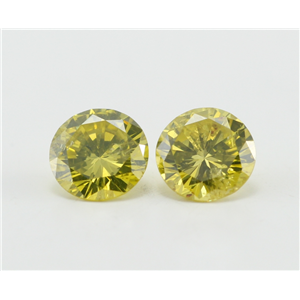 A Pair of Round Cut Loose Diamonds (0.9 Ct, Fancy Yellow (Color Irradiated) Color, I1-I2 Clarity)