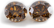 Beautiful Pair of 2.39 Carat Natural Fancy Orange Brown Round Cut Loose Diamonds, SI1-SI2 Clarity