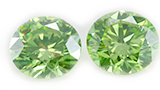 Pair of IGL Certified 1.07 Ct Irradiated Fancy Intense Olive Green Round Cut Loose Diamonds, VVS2-VVS1 Clarity (Clarity Enhanced)
