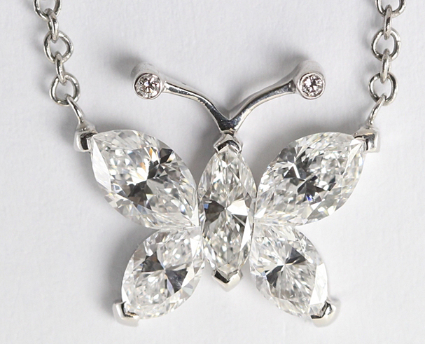 18k white gold invisible setting marquise cut 1.17 carat diamond butterfly pendant with a link chain and lobster-claw clasp