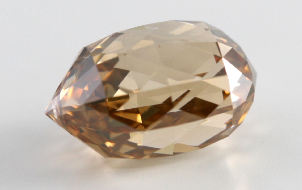 A natural mined 4.24 carat loose diamond with a fancy brown orange color with a grade of SI1 and with a GIA certificate.