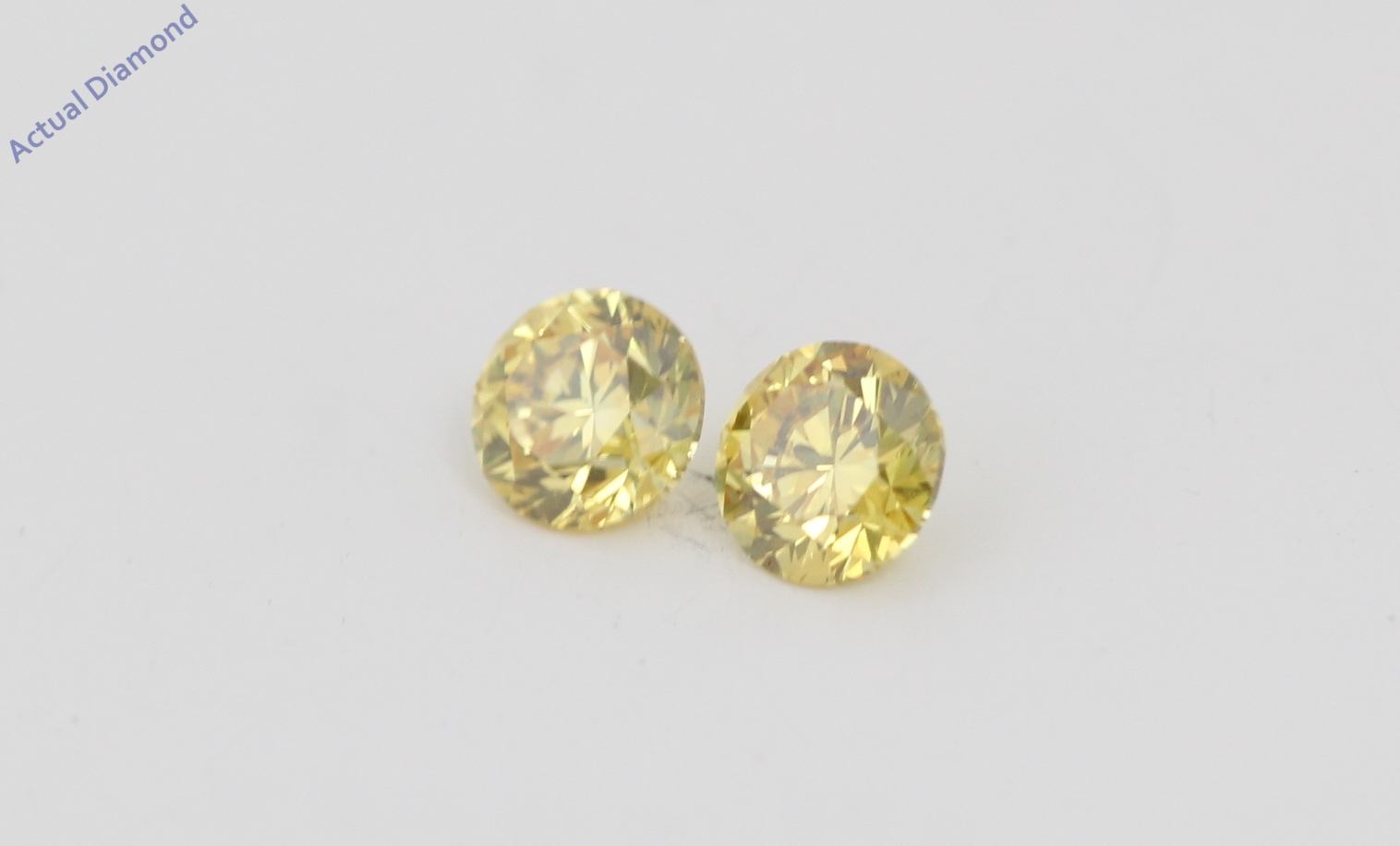 A Pair of Round Cut Loose Diamonds (0 41 Ct, Natural Fancy Vivid Yellow  Color, VVS2-VS1 Clarity) IGL Certified