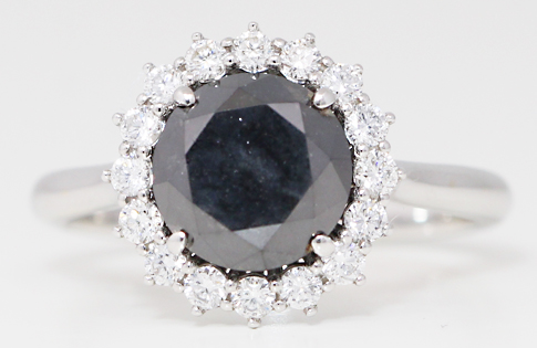 Black color enhanced diamond ring